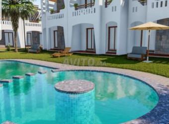 votre bungalow vu piscine a 400m de la plage